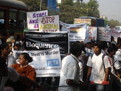SIES College students & PETA join hands to march against Animal abuse .