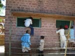 Visitors Climb Wall to Look Through a Window of Tiger Cage