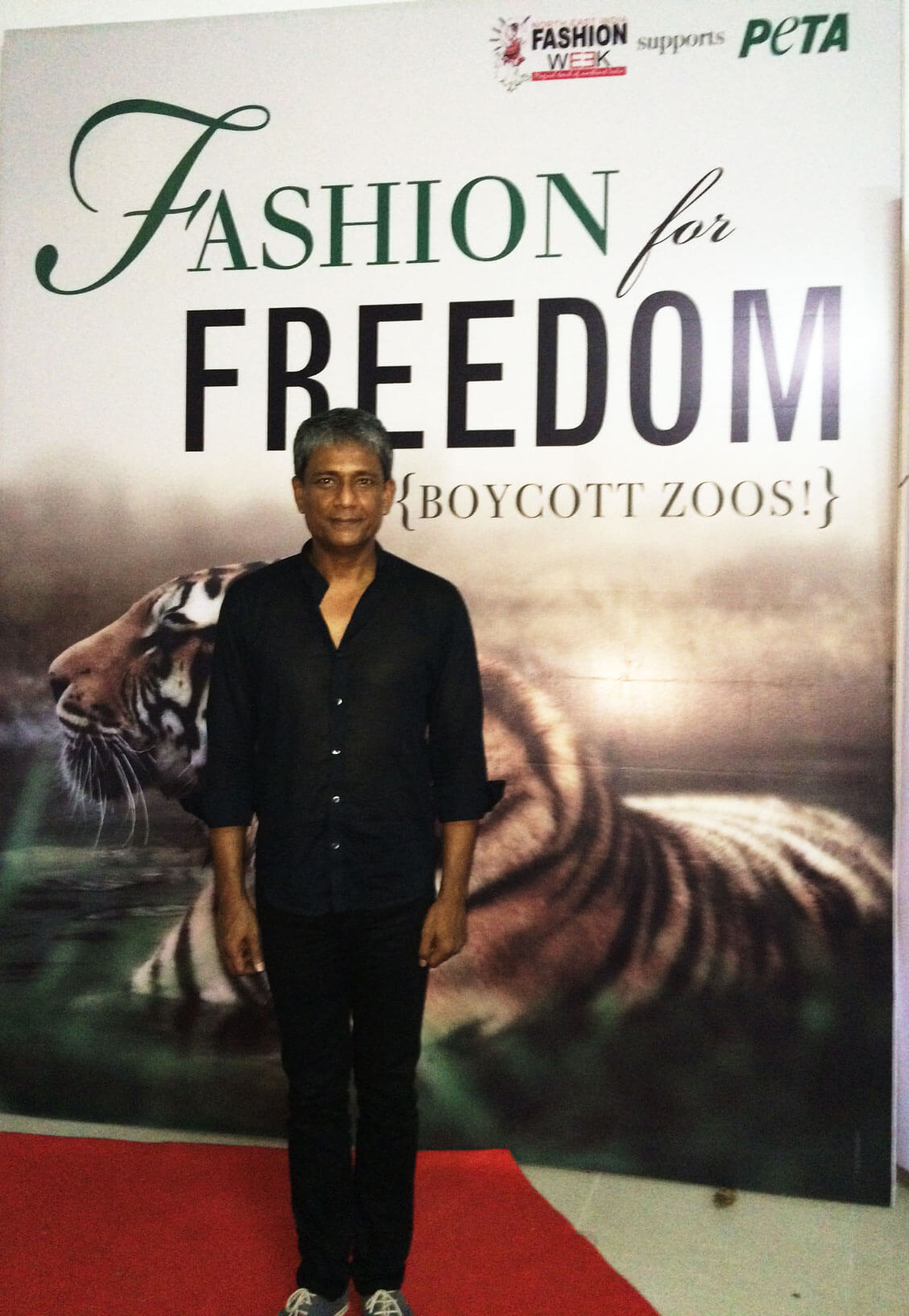 Adil Hussain with PETA Backdrop