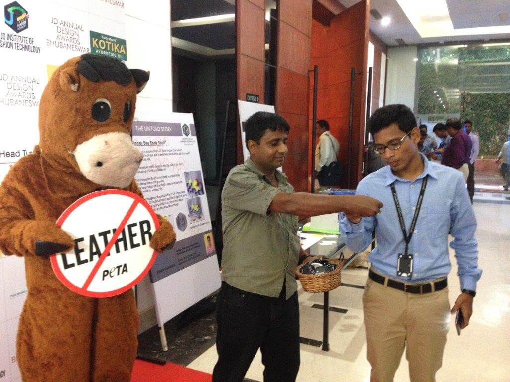Cow distributing badges to the guests