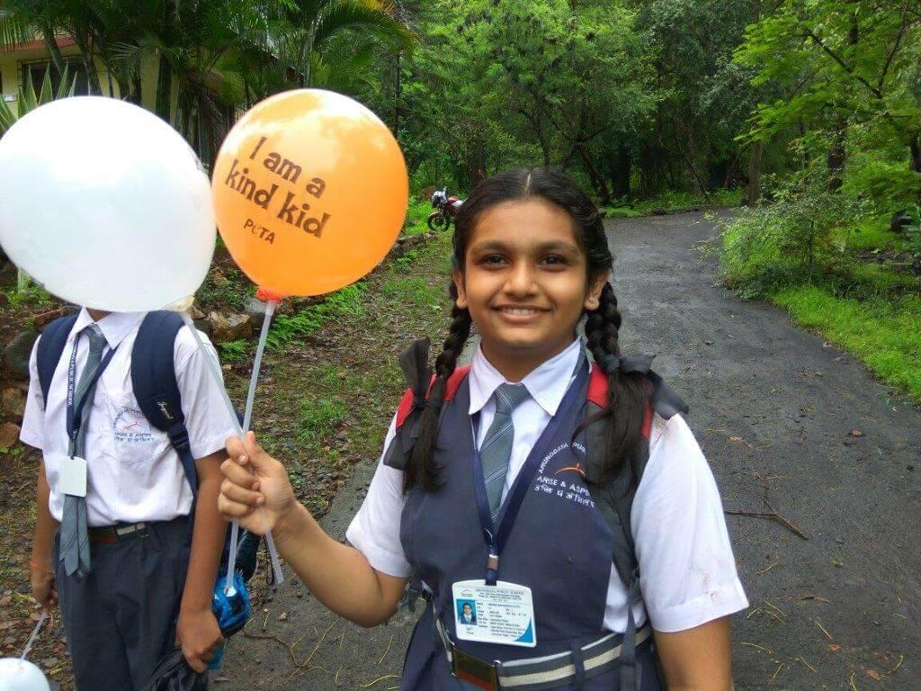 Girl with PETA balloon