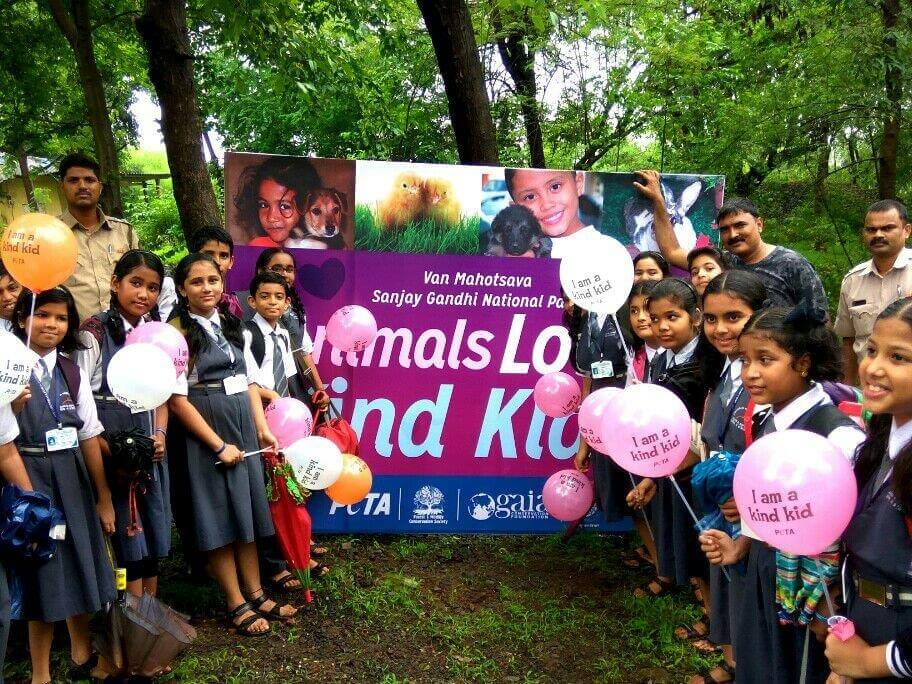 Students with PETA backdrop