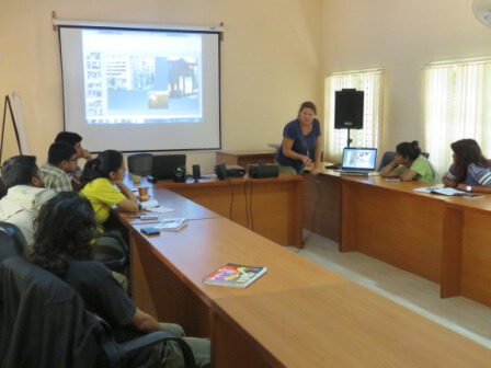 Elephant expert Margaret Whittaker talks to mahouts and veterinarians.