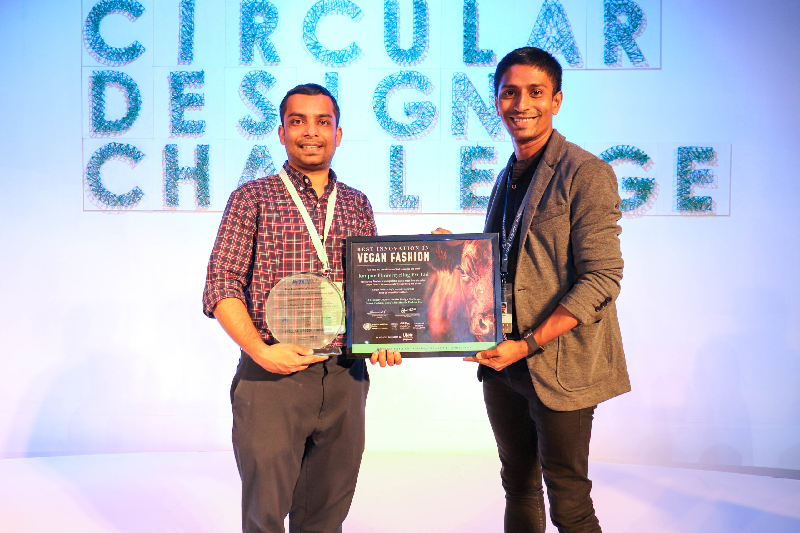 Ankit Agrawal (Left) receiving award from Sachin Bangera, Director of Public Relations and Celebrity at PETA India